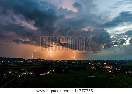 High Angle View Of Storm And Lightning Over Villages