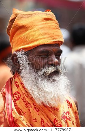 Pune, India  -  july 11, 2015: An Indian Sage Of The Hindu Tradition Meditating On His Way To A Pil