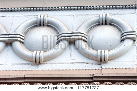 Historic Douglass Hotel a landmark in Houghton Michigan has many elaborate architectural designs. This circle design is part of many frieze elements in its architecture.