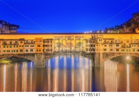 poster of View of medieval stone bridge Ponte Vecchio and the Arno River from the Ponte Santa Trinita in Florence, Tuscany, Italy.