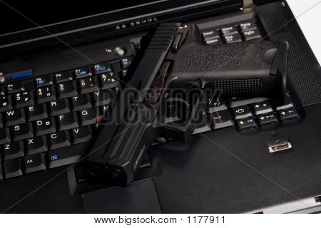 Shot? Black Weapon And Laptop