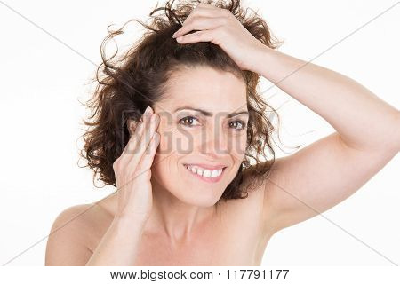 Woman Staring At The First Grey Hair On Her Scalp, A First Sign Of Aging,
