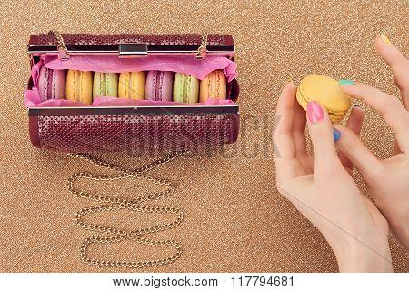 Macarons, fashion handbag, woman hand,gold.Vintage
