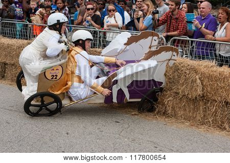 Competitors Crash Vehicle Into Hay Bales At Soap Box Derby