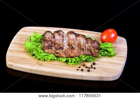Tasty grilled ribs on a lettuce leaf