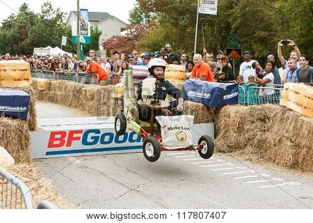 Man Steers Furniture Vehicle Over Ramp In Soap Box Derby