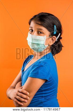 indian girl wearing face mask, Flu illness child girl in medicine healthcare mask