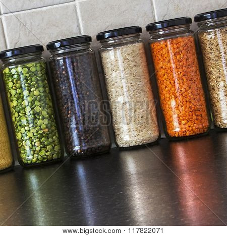 Health Food - Variety Of Seeds And Pulses In Jars, With Reflections.
