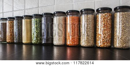 Health Food - Herbs, Seeds And Pulses In Spice Jars.