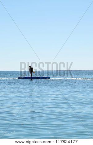 Skin-diver On Float Board