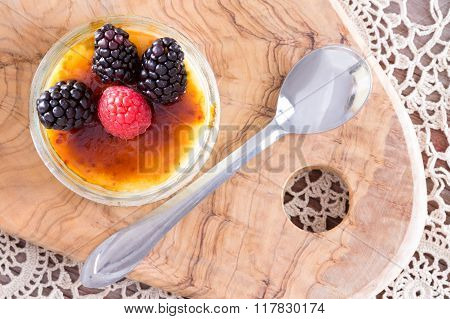 Scrumptious Brulee With Raspberries And Spoon