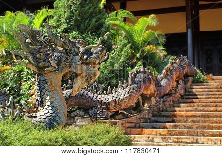 DALAT, VIETNAM - 04 DECEMBER 2011:The dragon guarding the entrance to the pagoda Linh An