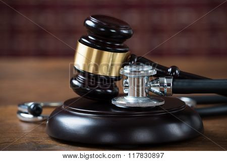 Stethoscope And Mallet In Courtroom