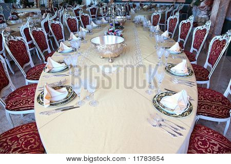 Centre Of Big Oval Dinner Table With Candlestick, Copper And Empty Dishes