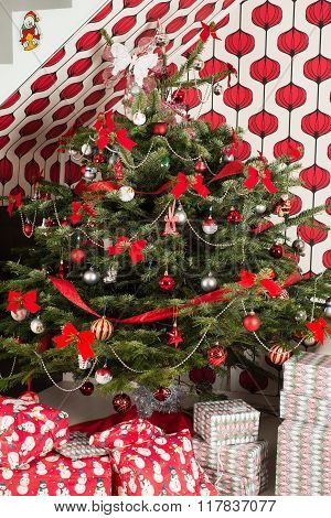 Natural Chrismas tree with gifts in living room