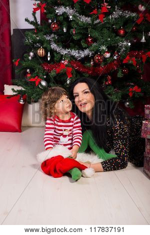Mother And Son With Christmas Tree