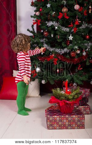 Toddler Boy Decorate Christmas Tree