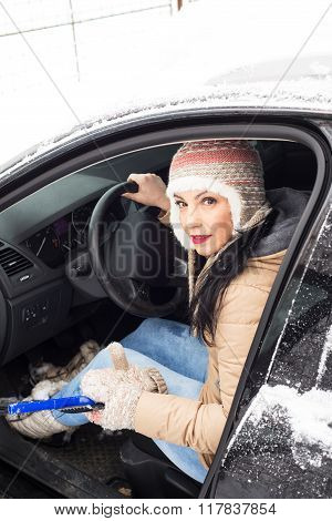Woman With Car In Snow
