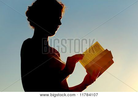 Young Curl Woman Reading Bible And Turning Page
