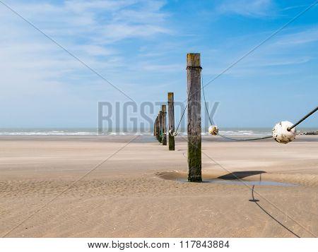 Row of wooden breakwaters
