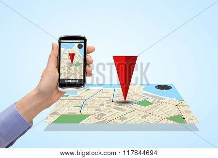 people, technology, navigation and media concept - close up of woman hand with smartphone with gps navigator map