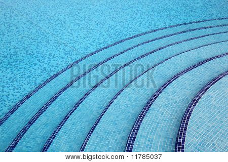 Steps Into Pool, Pure, Transparent Water, Blue Tiles On Bottom Of Pool