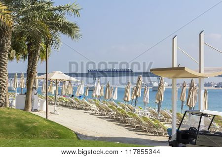 background landscape view of beach on the island of Palma with umbrellas and sunbed