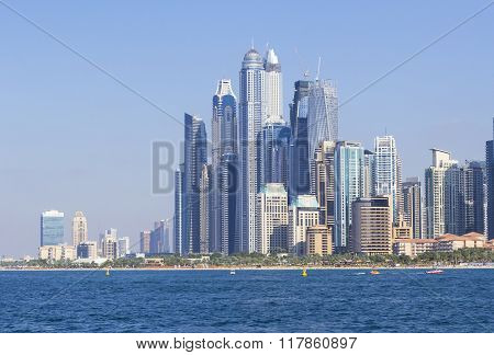 background view from the sea on a beautiful skyscrapers in Dubai Marina