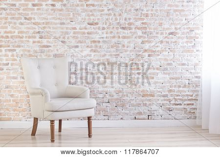 White Armchair In Loft Interior