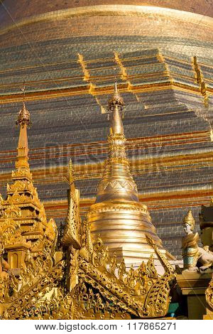 The Beautiful Multiple Gold Layers Of The Shwedagon Pagoda Glisten In The Early Morning Sun