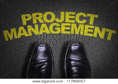 Top View of Business Shoes on the floor with the text: Project Management