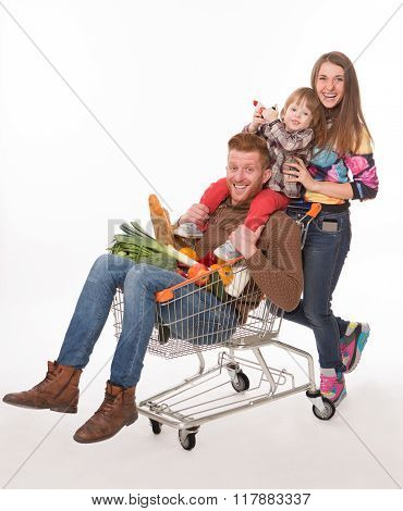 Happy family with a shopping cart in supermarket