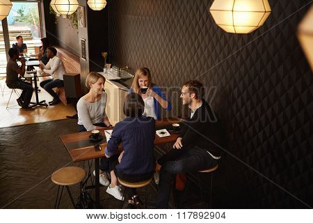 Group of friends meeting for cappucinos in a coffee shop