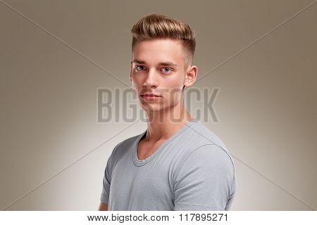 Portrait Of Stern Looking Male Teenager Ii