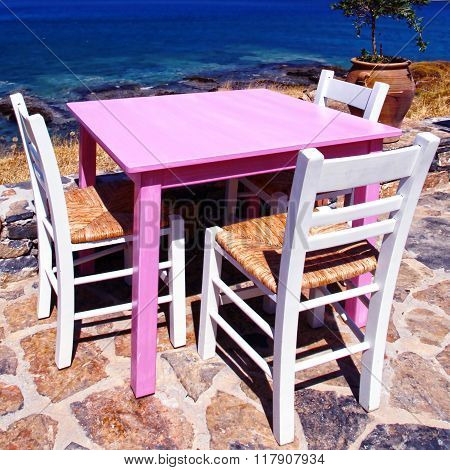 Traditional Greek Tavern On The Beach Of Mediterranean Sea