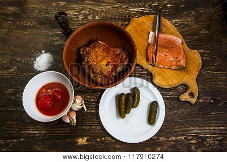 Still Life With Grilled Meat Of Turkey And Salt Salmon Fillet