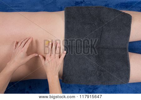 Laid Man Being Massaged By A Female Hands Therapist