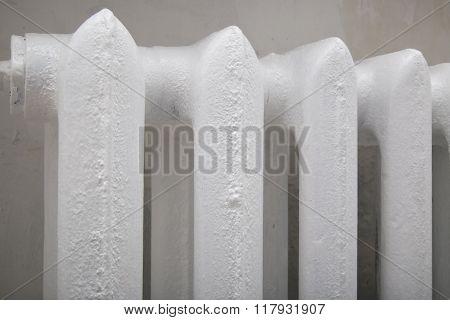 Heating white cast iron radiator