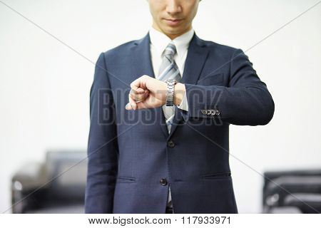 Businessman watching his wrist watch