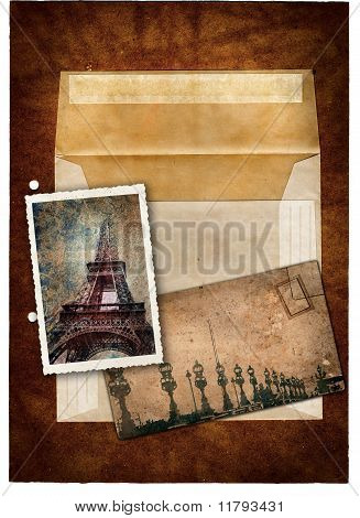 grunge postcard and picture with Eiffel Tower and bridge in Paris and empty envelop on a dark texture background . poster