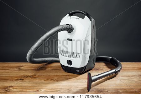vacuum cleaner on grey background