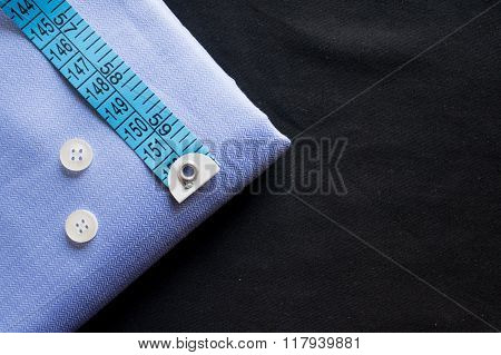 Tailoring essentials fabric, buttons and measuring tape
