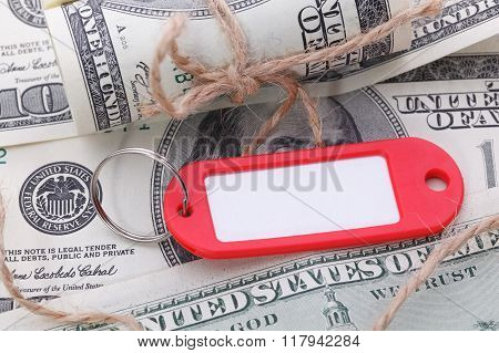 Money And Business Idea. Red Key Fob With Dollars Bills