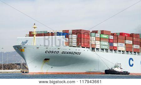 Tugboat Sandra Hugh Assisting Cargo Ship Cosco Guangzhou To Maneuver Into The Port Of Oakland