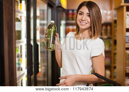 Woman Buying Some Green Water
