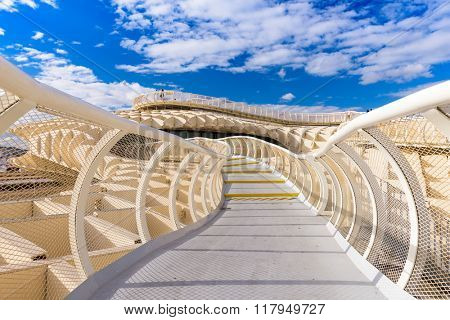 SEVILLE, SPAIN - OCTOBER 7, 2014: The Metropol Parasol walkway. Located in the old quarter, the structure opened to public controversey in 2011.