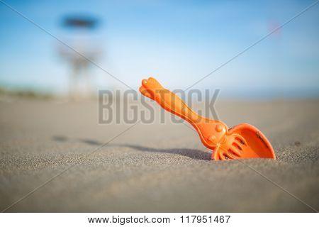 Children's beach toys.Sand shovel for kids.Children beach entertainment equipment for sandy beach vacation.Creativity and beach relaxation.Summer family activity recreation concept poster