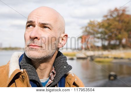 Head and shoulders of a bald man
