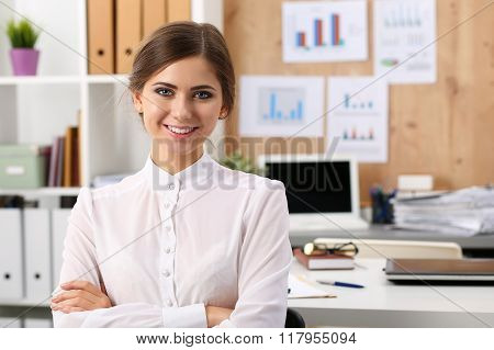 Beautiful Smiling Businesswoman Standing In Office