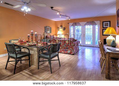 Stylish open concept apartment interior with orange walls and decor.